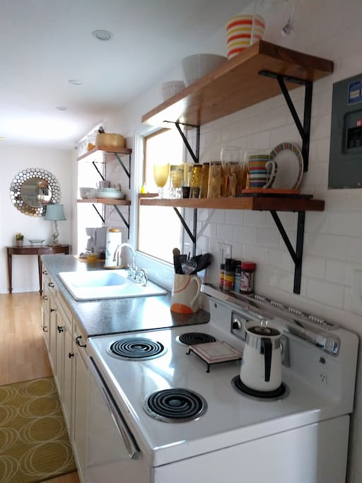 fully equipped kitchen,  pots, pans, dishes silverware,ect...no dishwasher, Original electric stove, works great!