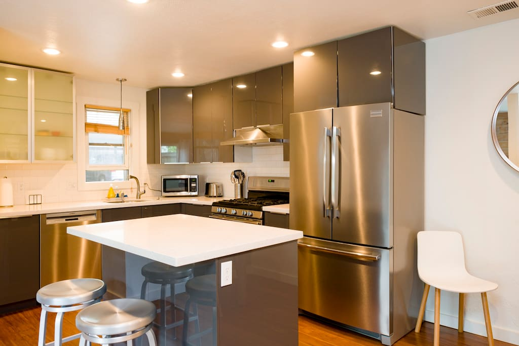 Chef's kitchen featuring stainless steel appliances and a gas range