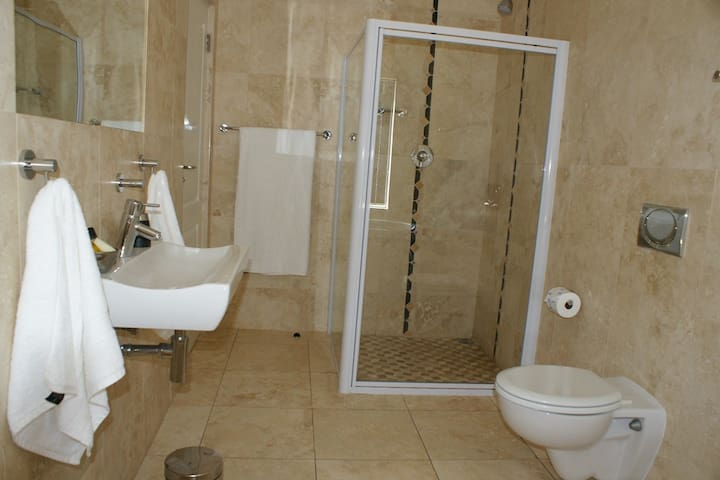En-suite bathroom with soaker tub and shower.