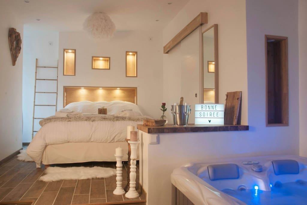 L 39 escapade romantique le nid spa privatif lofts for Chambre hote romantique