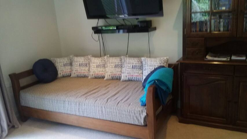 A comfortable king single available for a third guest which is a handy day bed when not being used as a bed.