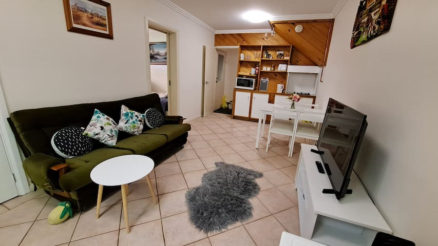 This is the comfortable living room, dining room and kitchenette area. Cozy and very well equipped with all the essentials to enjoy your stay.