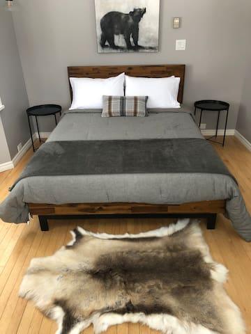 Main floor bedroom with new queen bed and mattress.