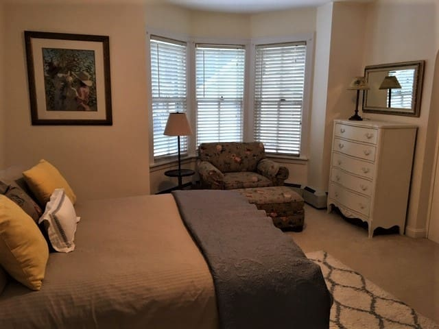 Cozy bedroom with sitting area - queen bed , lots of storage space and TV in armoir (not pictured