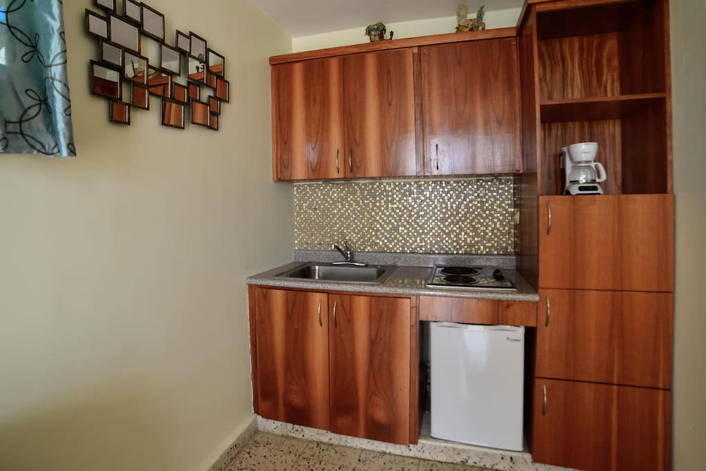 Efficiency kitchen with all you need to prepare simple meals and snacks