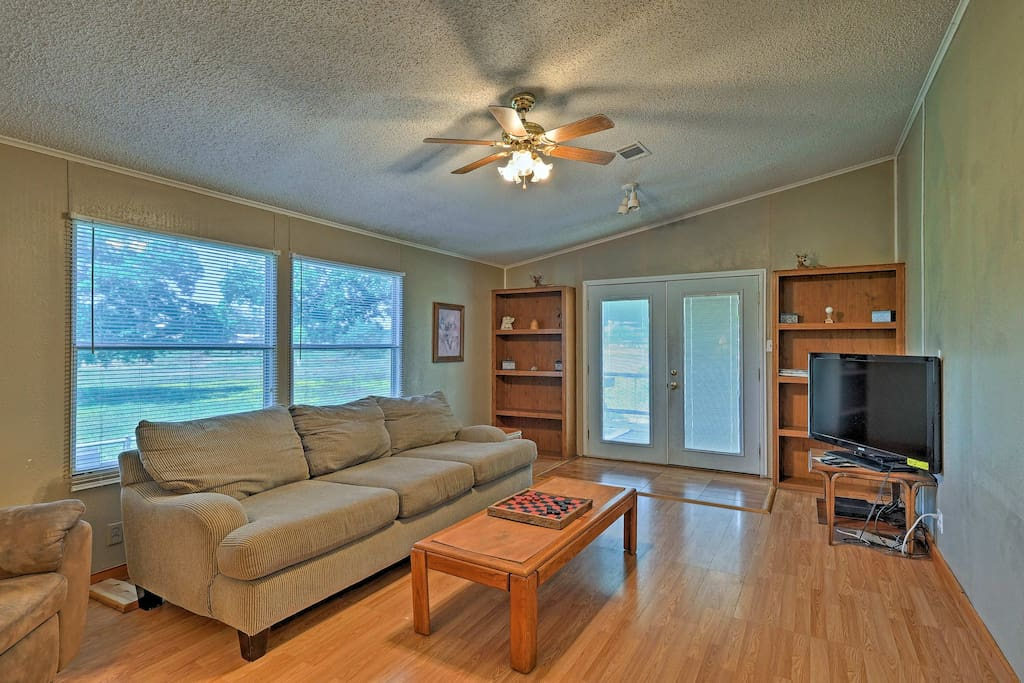 Up to 14 guests can stay at this 3BR, 2-bath home right by the water.