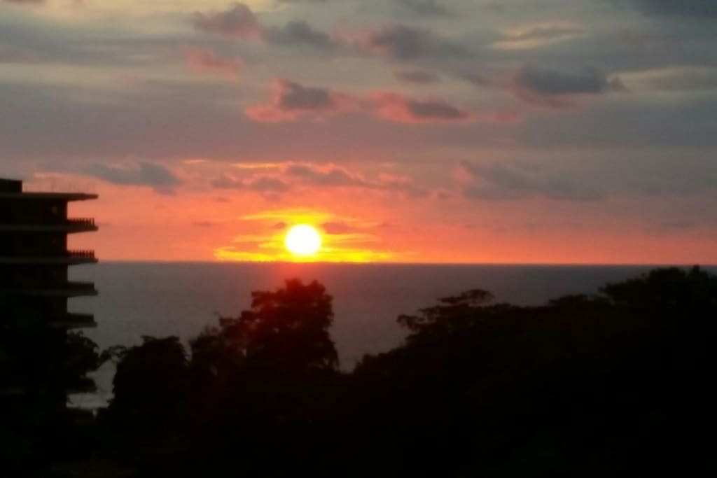 Beautiful sunset seen from the  balcony, family/dining rooms and two bedrooms.