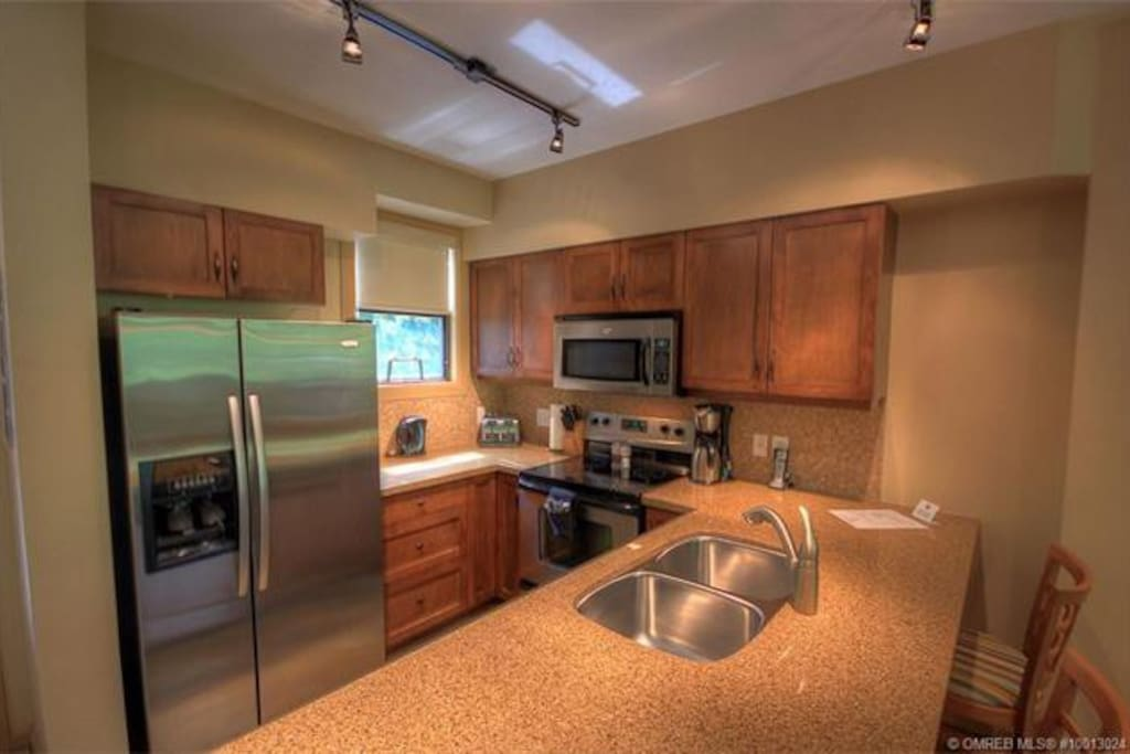 Kitchen fully stocked with Stainless steel Appliances and Granite countertops.