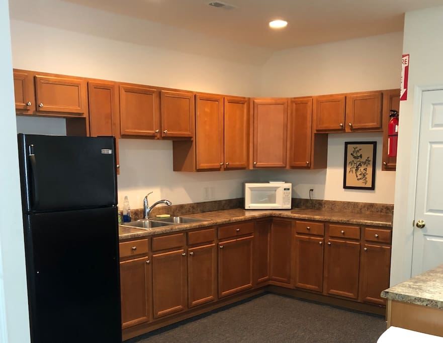 Kitchen has refrigerator, microwave, coffee maker and electric skillet.