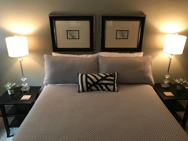 Queen bed. Room darkening shade. Fan.