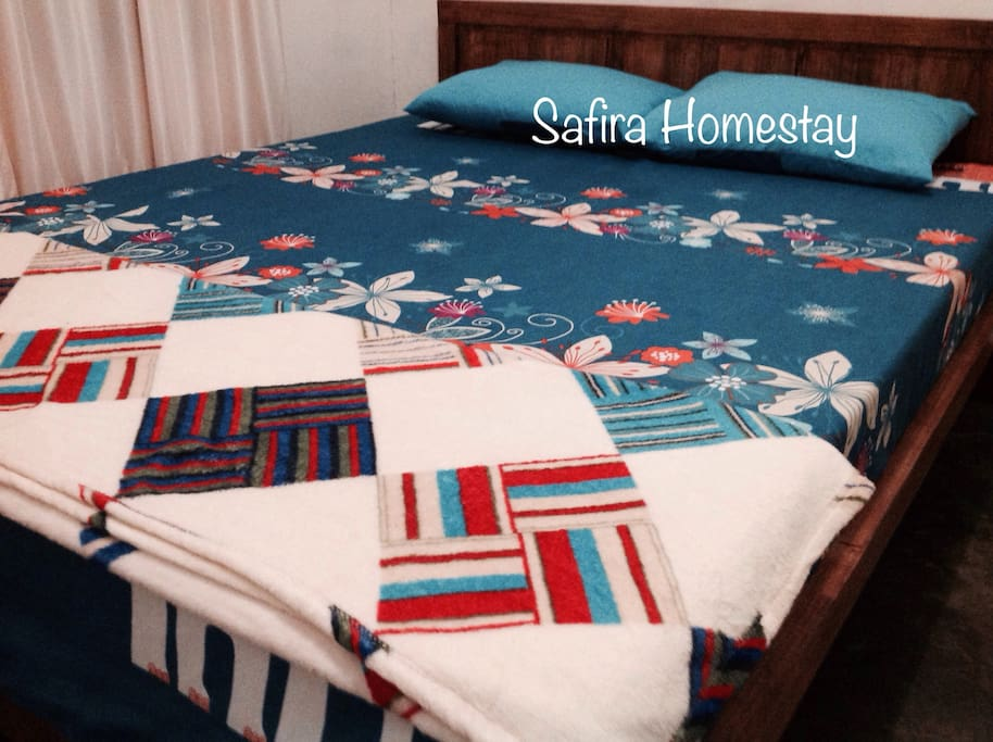 Tempat tidur di Muanay Room