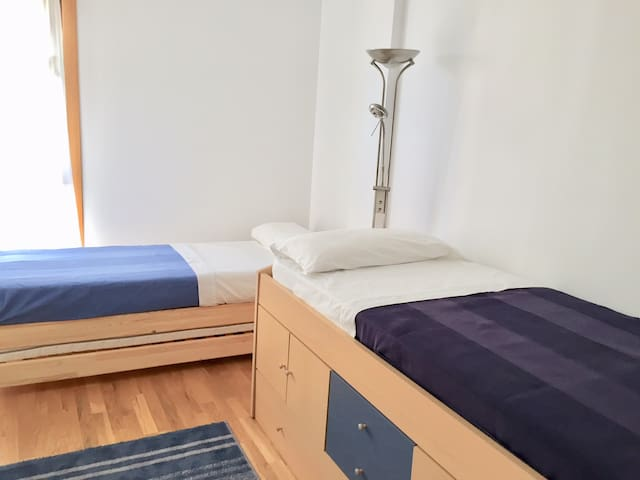Two single beds for kids or friends.