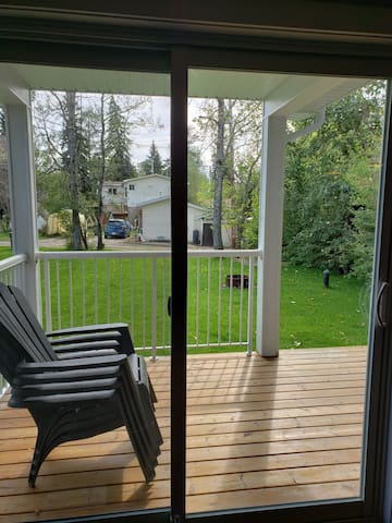 Back 16'x8' 1/2 covered deck and BBQ. BBQ striker doesn't work so use long BBQ  lighter supplied. Good size yard. Please do not drive on lawn as only 3 years old. Large front driveway fits 3 vehicles. No fence yet, but good friendly neighbours.