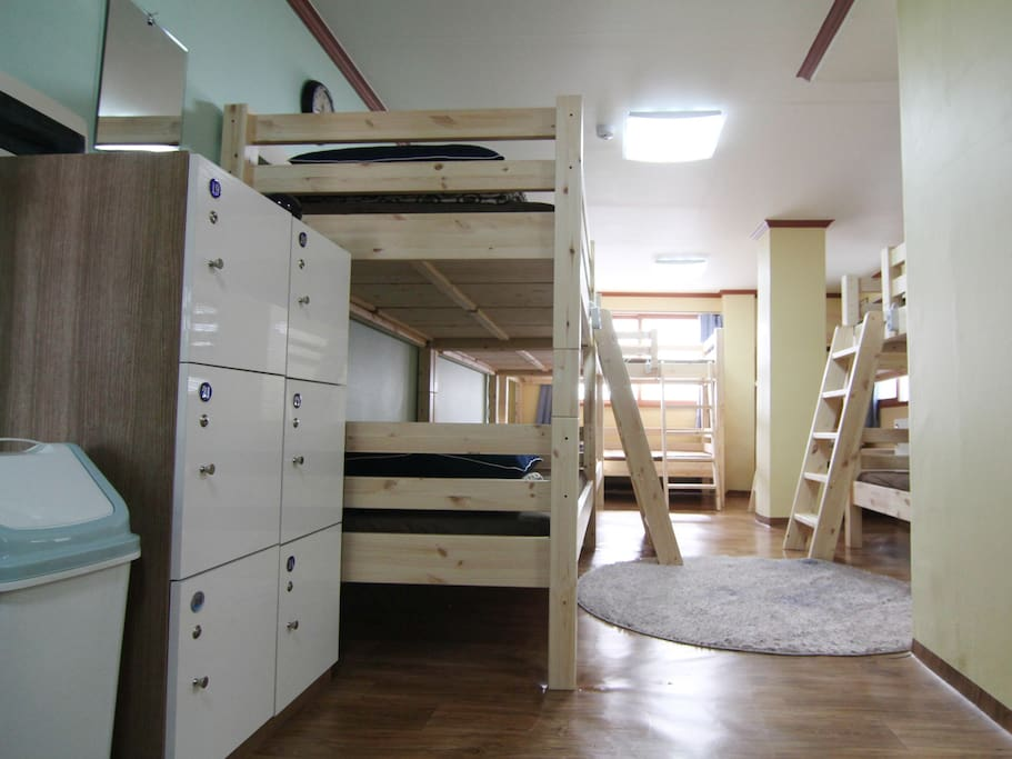 10 bed dormitory room for male with one bathroom.