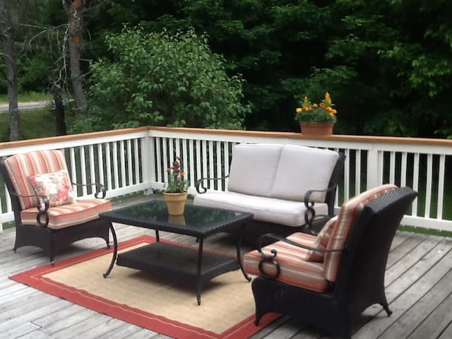 FRONT DECK WITH DINING TABLE AND OUTDOOR LIVING ROOM
