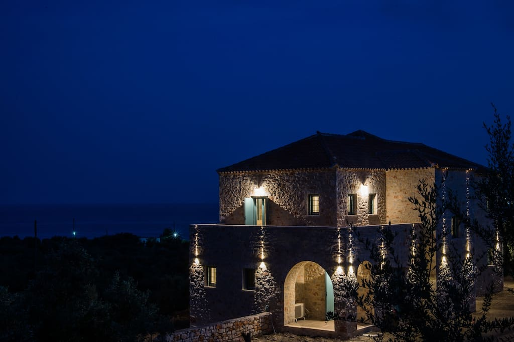 The Olive Yard is beautifully lit up at night.