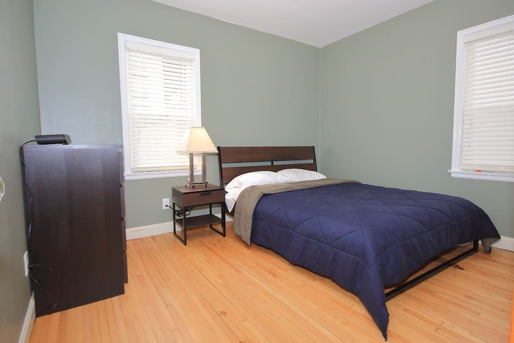 Queen Bedroom comfortably sleeps two people. Closet and dresser available for your use.