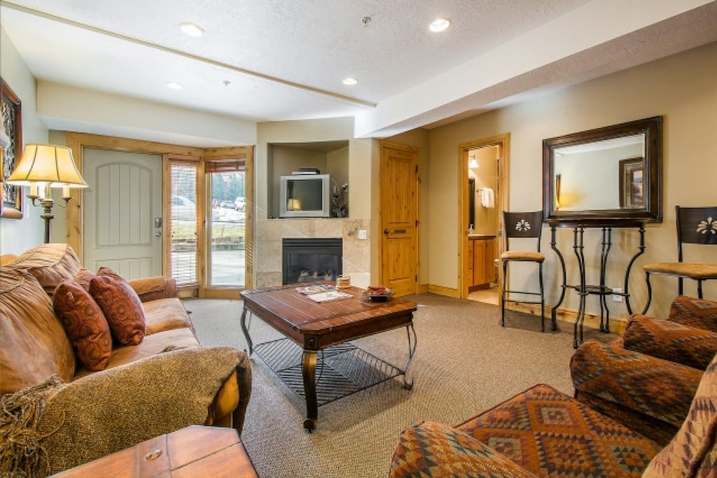 The main living space is outfitted with recessed lighting; giving a bright and welcoming feel to the area.