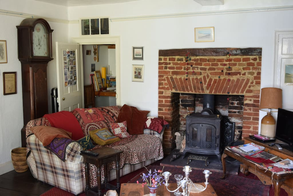 A corner of the sitting room with open fire and TV