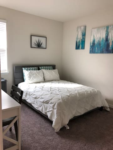 Queen bed in clean, modern, private bedroom