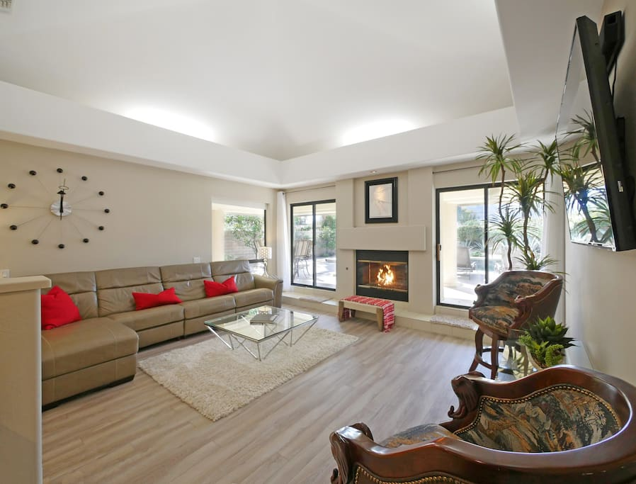 Living room with fireplace and views to the yard