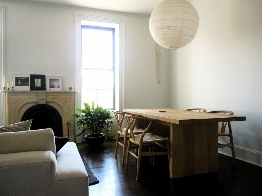 Living/Dinning room: original useable fireplace.