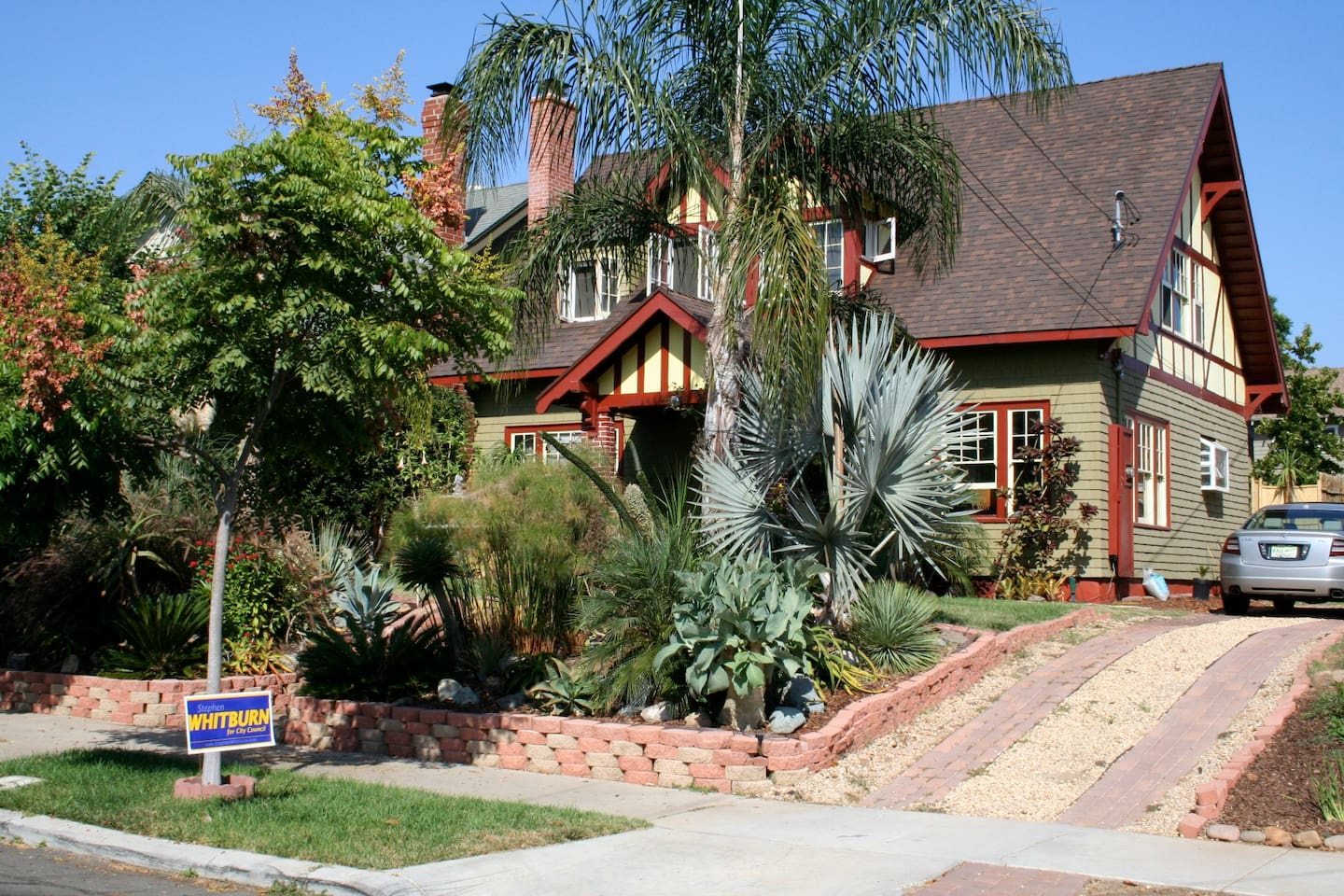 Welcome to the Heart of Sunny South Park and this Renovated Historical Tudor Craftsman built in 1914.