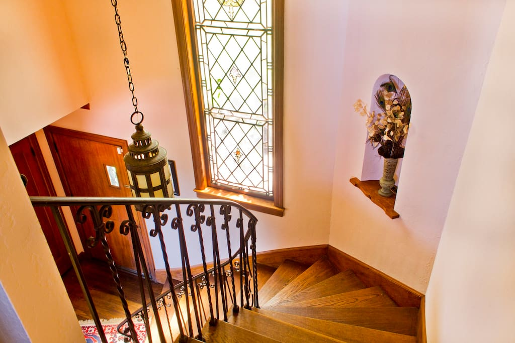 The staircase leads to the main bedroom floor.