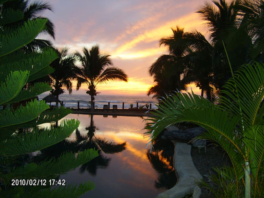 Sitting on your terrace looking over our pool at unbelievable sunsets