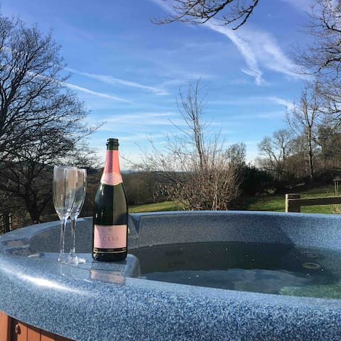 Enjoy your drink from a luxurious hot-tub with views of mountains by day and stars by night