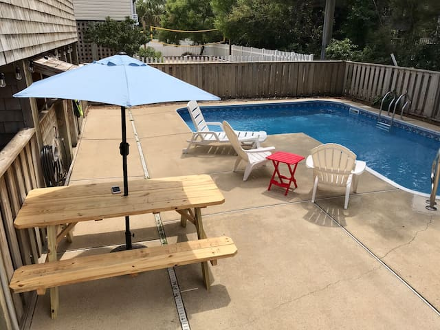 Upgraded pool area with a bbq grill , a picnic table & pool furniture .  The pool is open from May thru October .