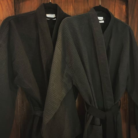 Two robes provided in the main bedroom