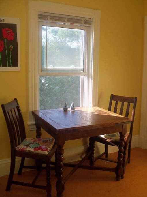 Kitchen   A small table for two, expands to seat 4, overlooks our tree filled backyard