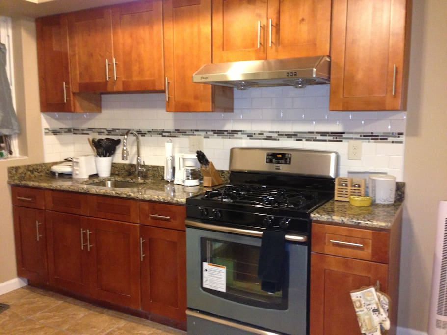 Fully equipt open kitchen with new stainless steel applicances and granite countertop