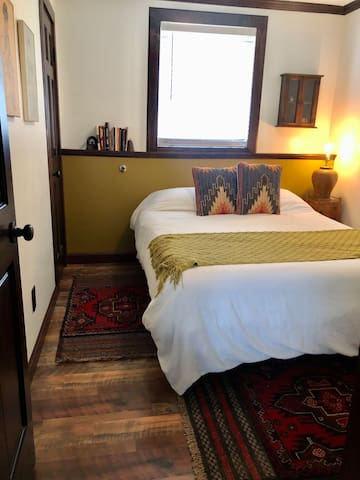 This is the smaller of two bedrooms with a queen size bed. There is a small closet in the far back left corner.