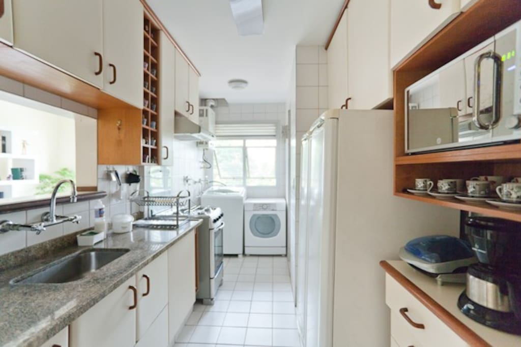Fully equiped kitchen, plus laundry area with washing and drying machines.