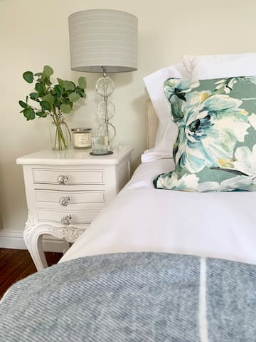 We have two tonal throws on the foot of the bed. Feel free to take these into the garden and snuggle up on the bench with views across the pond and valley.