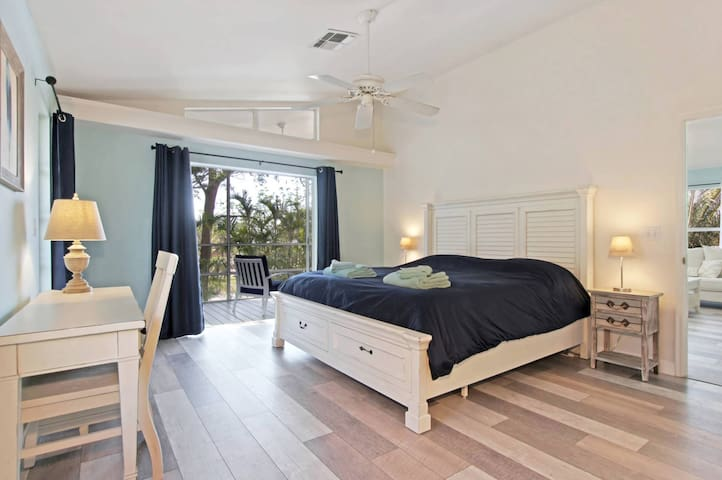 Master Bedroom with desk and direct access to beautiful lanai.
