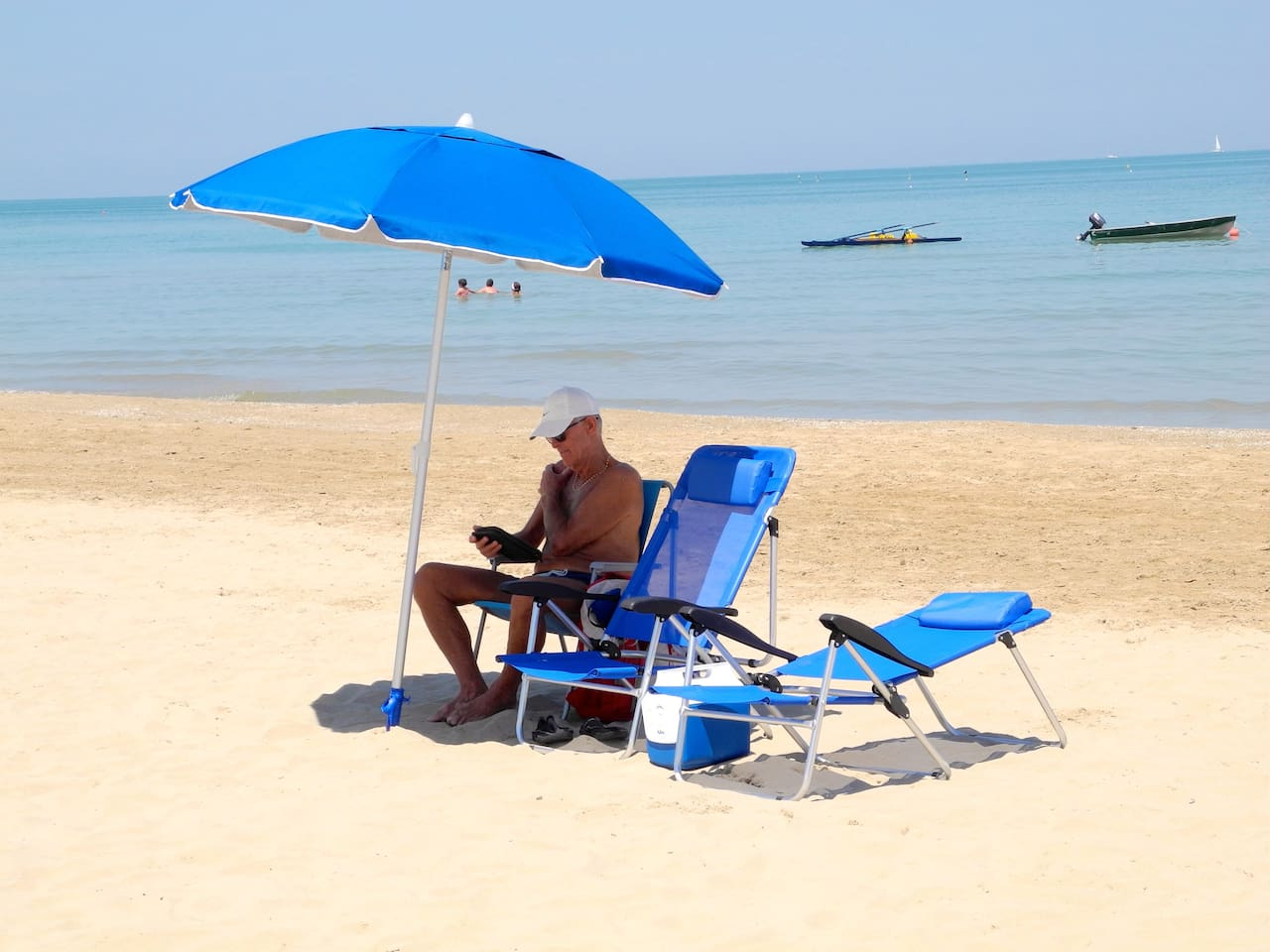 Relax at the beach with the umbrella,  beach chairs & cooler