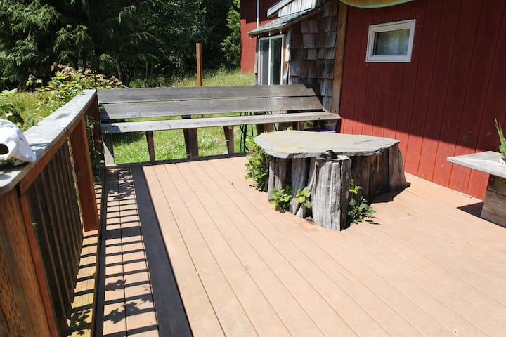 Nice deck space with a stone table mounted on an old Cedar trunk.