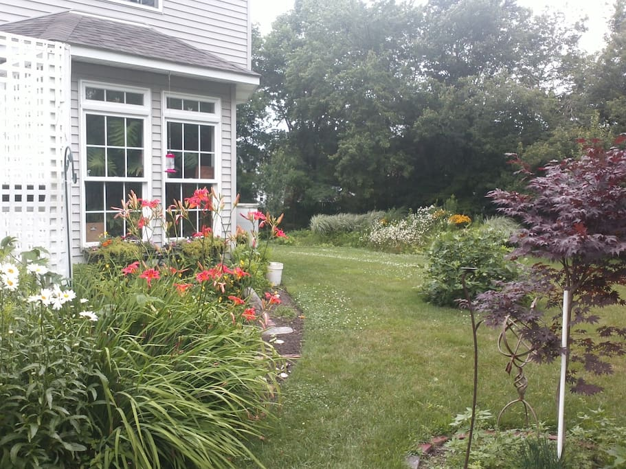 Our Narragansett hide away is surrounded by many seasonal floral borders and organic vegetable gardens.