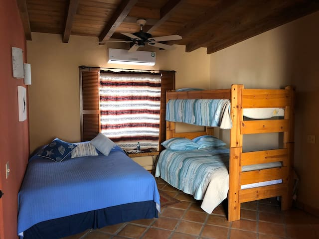 """Bedroom 3 or as we call the """"bunk room"""" this room also as it's own private access to the patio and street side of the house"""