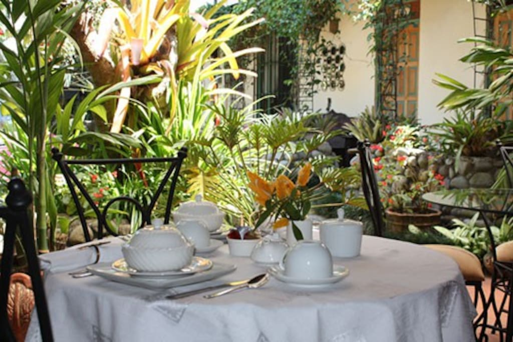 Breakfast Table. Each Morning you will be served a delicious breakfast on our garden terrace.