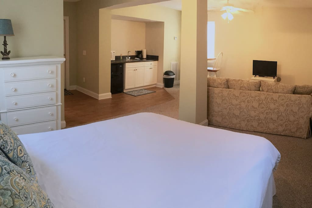 Queen sized bed with new mattress, down comforter