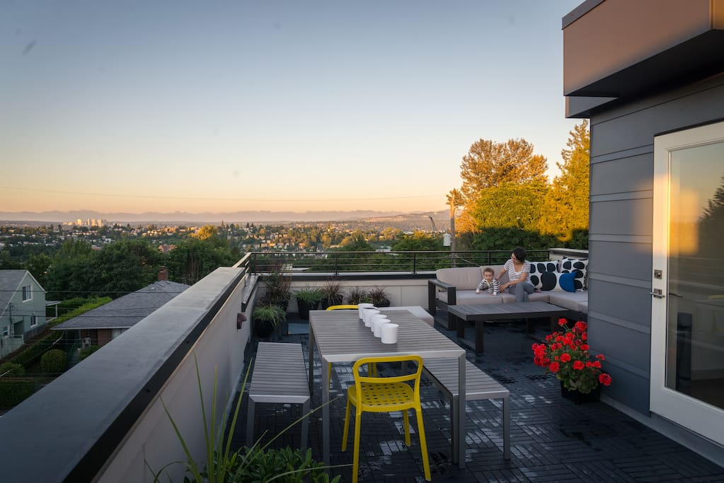 View from our rooftop lounge facing the Cascade Mountains and Mount Rainier (to the right) during a gorgeous, typical Seattle summer evening.