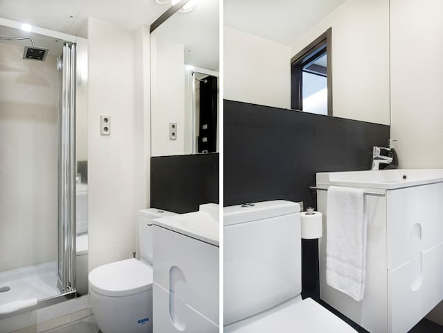 The brand new bathroom has a shower try, sink and toilet.