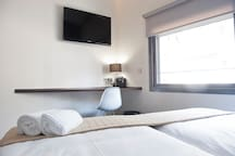 Ample room with 2 single beds, large 40' TV, free internet ADSL.