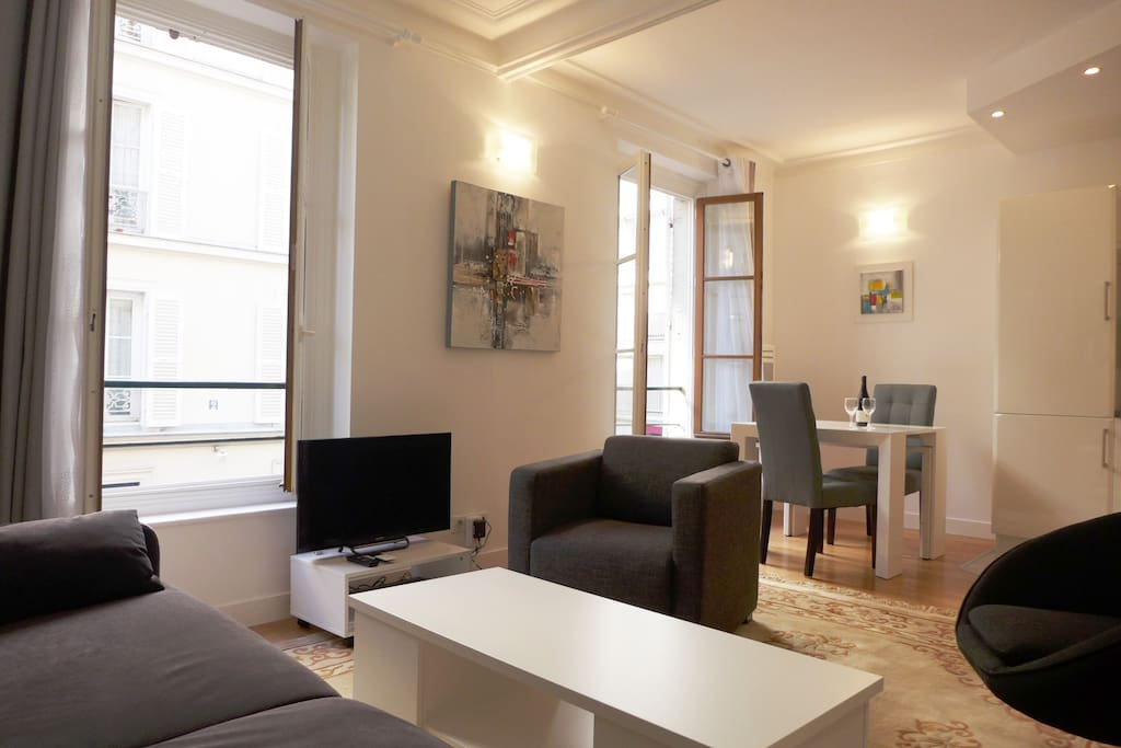 Apt. PONCELET - Paris - The living & dining room has 2 big windows.