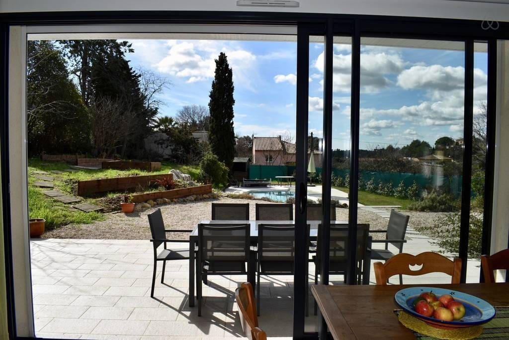 Looking from the main room to the terrace, garden and pool