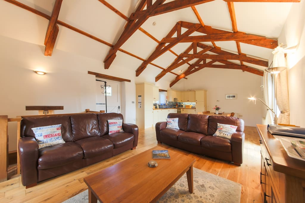 High-beamed ceilings in the open-plan kitchen/lounge area